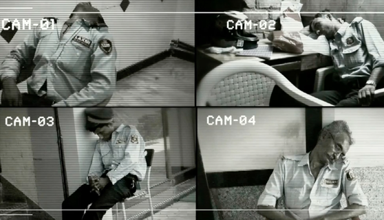 sleeping security guard image